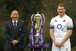 FILE- In this Jan. 24, 2018 file photo, Six Nations England rugby team coach Eddie Jones and captain Dylan Hartley, right, pose for photographers with the trophy during the Rugby 6 Nations tournament launch in London. Hartley is one of a host of big names to be missing the first Rugby World Cup in Asia. (AP Photo/Frank Augstein)