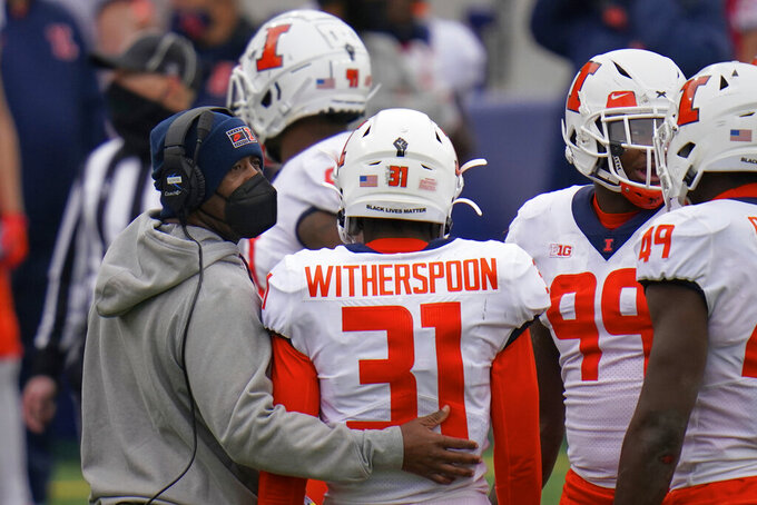 Illinois head coach Lovie Smith stands with Illinois defensive back Devon Witherspoon (31) during the first half of an NCAA college football game against Nebraska in Lincoln, Neb., Saturday, Nov. 21, 2020. (AP Photo/Nati Harnik)