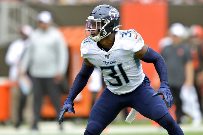 FILE - In this Sunday, Sept. 8, 2019, fie photo, Tennessee Titans free safety Kevin Byard (31) lines up in the first half of an NFL football game against the Cleveland Browns in Cleveland.     Byard became the NFL's highest-paid safety in July just before training camp, and he got his 13th career interception in the Titans' opening win at Cleveland. (AP Photo/David Richard)