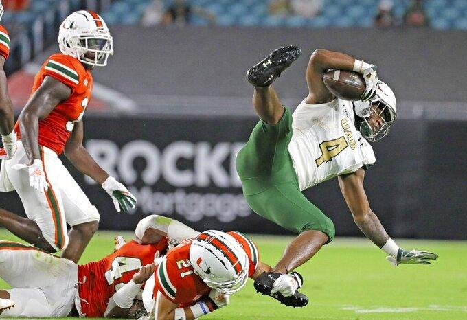 UAB's Austin Watkins Jr. (6) advances the ball in the first quarter against Miami hosts during an NCAA college football game in Miami Gardens, Fla., Thursday, Sept. 10, 2020. (Al Diaz/Miami Herald via AP)