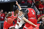 Louisville guard Ryan McMahon (30) tries to fight his way through the screen of Miami (Ohio) forward Precious Ayah (5) to get to guard Isaiah Coleman-Lands (4) during the second half of an NCAA college basketball game in Louisville, Ky., Wednesday, Dec. 18, 2019. Louisville won 70-46. (AP Photo/Timothy D. Easley)