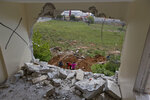 A hole is seen in one of the two apartments belonging to the father of Arafat Erfayieh, that was demolished by Israeli forces in the West Bank city of Hebron, Friday, April 19, 2019. The Israeli military has demolished the family home of Arafat Erfayieh, a Palestinian charged with the killing of a 19-year-old Israeli woman. (AP Photo/Nasser Nasser)