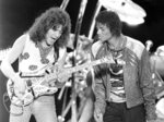 FILE - This July 14, 1984 file photo shows Van Halen guitarist Eddie Van Halen, left, performing