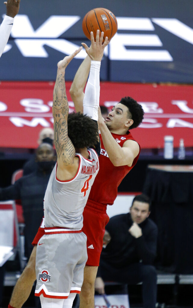 Rutgers guard Geo Baker, right, goes up for a shot against Ohio State guard Duane Washington during the first half of an NCAA college basketball game in Columbus, Ohio, Wednesday, Dec. 23, 2020. (AP Photo/Paul Vernon)