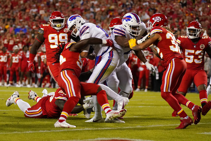 Buffalo Bills quarterback Josh Allen scores during the first half of an NFL football game against the Kansas City Chiefs Sunday, Oct. 10, 2021, in Kansas City, Mo. (AP Photo/Charlie Riedel)