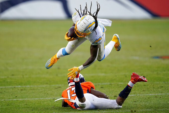Los Angeles Chargers strong safety Rayshawn Jenkins, top, is tackled by Denver Broncos wide receiver K.J. Hamler (13) after Jenkins intercepted a pass during the second half of an NFL football game, Sunday, Nov. 1, 2020, in Denver. (AP Photo/David Zalubowski)