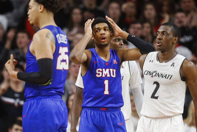 SMU's Feron Hunt (1) reacts to a foul call alongside Cincinnati's Keith Williams (2) during the second half of an NCAA college basketball game Saturday, Feb. 2, 2019, in Cincinnati. (AP Photo/John Minchillo)