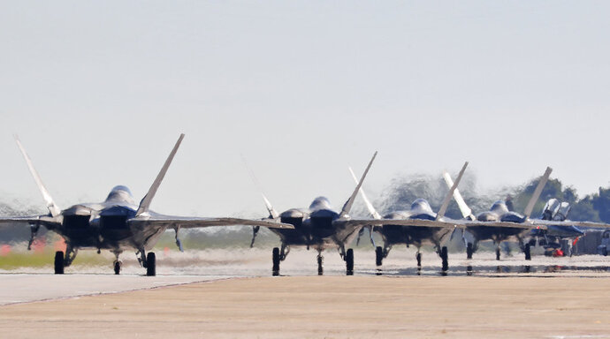 F-22s taxi down the runway as they prepare to depart Langley Air Force Base, Va., Tuesday morning, Sept. 11, 2018, as Hurricane Florence approaches the Eastern Seaboard. Officials from Joint Base Langley-Eustis in Hampton said the base's F-22 Raptors and T-38 Talon training jets, as a precaution, were headed for Rickenbacker Air National Guard Base in central Ohio. (Jonathon Gruenke/The Daily Press via AP)
