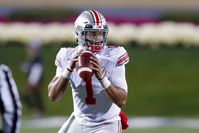 Ohio State quarterback Justin Fields looks to pass during the first half of an NCAA college football game against Northwestern Friday, Oct. 18, 2019, in Evanston, Ill. (AP Photo/Charles Rex Arbogast)