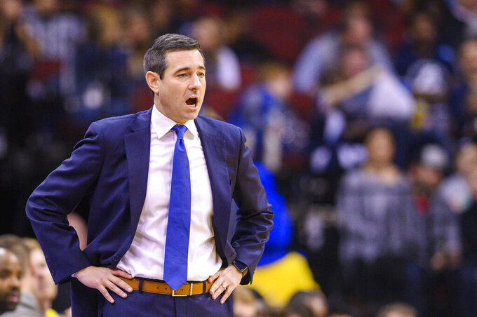 Delaware head coach Martin Ingelsby reacts during the first half of the Never Forget Tribute Classic NCAA college basketball game against Villanova, Saturday, Dec. 14, 2019, in Newark, N.J. (AP Photo/Corey Sipkin)