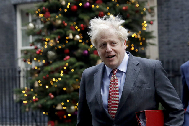 British Prime Minister Boris Johnson leaves 10 Downing Street in London, to attend a cabinet meeting at the Foreign, Commonwealth and Development Office, Tuesday, Dec. 8, 2020. Britain's rollout of the COVID-19 vaccine on Tuesday has been dubbed