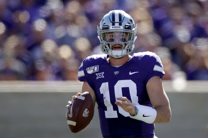 Kansas State quarterback Skylar Thompson (10) looks for a receiver during the first half of an NCAA college football game against TCU Saturday, Oct. 19, 2019, in Manhattan, Kan. (AP Photo/Charlie Riedel)