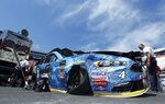 The car of driver Kevin Harvick is seen after crashing during practice for a NASCAR Monster Series auto race on Friday, April 13, 2018, in Bristol, Tenn. (AP Photo/Wade Payne)