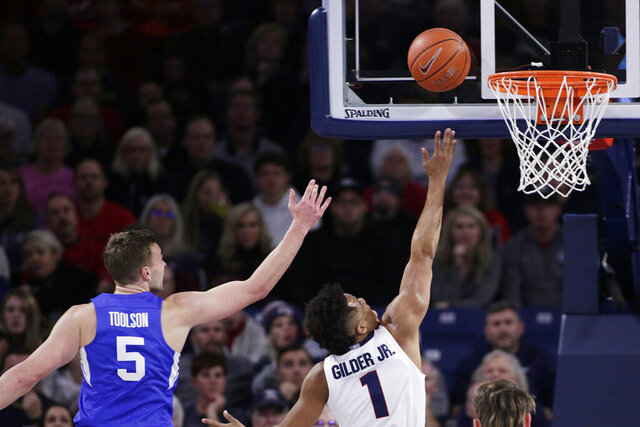 Gonzaga guard Admon Gilder (1) shoots in front of BYU guard Jake Toolson (5) during the first half of an NCAA college basketball game in Spokane, Wash., Saturday, Jan. 18, 2020. (AP Photo/Young Kwak)