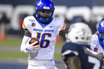 Boise State wide receiver John Hightower (16) runs on the way to a 30-yard touchdown reception as Utah State cornerback DJ Williams (7) defends during the first half of an NCAA college football game Saturday, Nov. 23, 2019, in Logan, Utah. (AP Photo/Eli Lucero)