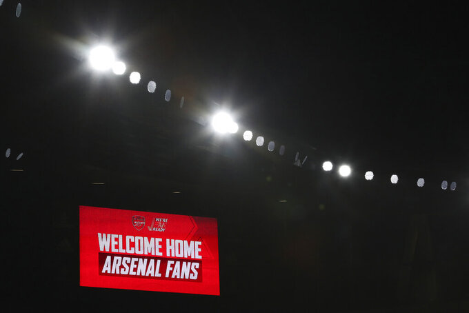 A sign welcomes a number of home fans allowed into an English Premier League soccer match between Arsenal and Burnley at the Emirates stadium in London, England, Sunday Dec. 13, 2020. (Catherine Ivill/Pool via AP)