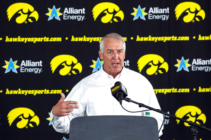 FILE - In this June 15, 2020, file photo, Iowa athletic director Gary Barta answers questions during a news conference in Iowa City, Iowa. Members of the University of Iowa women's swimming and diving team sued the school Friday, Sept. 25, 2020, arguingthat adecision to eliminate their program violates a landmark gender equity law. Iowa athletic director Gary Barta announcedlast monththat men's and women's swimming and diving, men's tennis and men's gymnastics would be cut after this school year. (Joseph Cress//Iowa City Press-Citizen via AP, File)