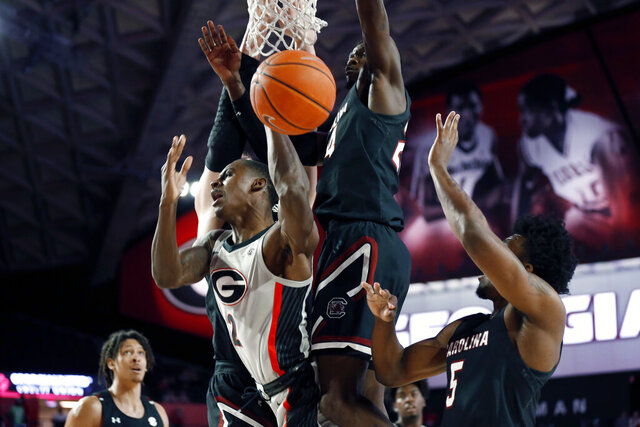 Georgia's Jordan Harris (2) is fouled by South Carolina forward Keyshawn Bryant (24) during an NCAA college basketball game Wednesday, Feb. 12, 2020, in Athens, Ga. (Joshua L. Jones/Athens Banner-Herald via AP)