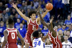 Oklahoma's Jalen Hill (1) and Kur Kuath (52) defend against Creighton's Denzel Mahoney (34) during the first half of an NCAA college basketball game in Omaha, Neb., Tuesday, Dec. 17, 2019. (AP Photo/Nati Harnik)