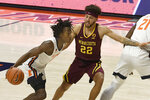 Illinois guard Ayo Dosunmu (11) powers past Minnesota's guard Gabe Kalscheur (22) in the first half of an NCAA college basketball game Tuesday, Dec. 15, 2020, in Champaign, Ill. (AP Photo/Holly Hart)