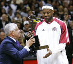 FILE - In this Tuesday, May 5, 2009 file photo, NBA commissioner David Stern, left, presents Cleveland Cavaliers' LeBron James with the 2008-2009 NBA Most Valuable Player trophy before the Cavaliers' Eastern Conference basketball semifinals game against the Atlanta Hawks in Cleveland. David Stern, who spent 30 years as the NBA's longest-serving commissioner and oversaw its growth into a global power, has died on New Year's Day, Wednesday, Jan. 1, 2020. He was 77.  (AP Photo/Mark Duncan, File)