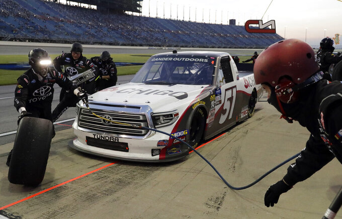 Brandon Jones makes a pit stop during the NASCAR Truck Series auto race at Chicagoland Speedway in Joliet, Ill., Friday, June 28, 2019. (AP Photo/Nam Y. Huh)