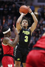 Purdue guard Carsen Edwards (3) shoots over Nebraska guard Glynn Watson Jr. (5) during the first half of an NCAA college basketball game in West Lafayette, Ind., Saturday, Feb. 9, 2019. (AP Photo/Michael Conroy)