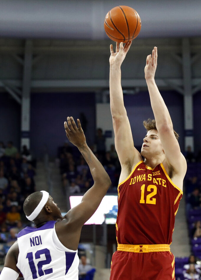 TCU forward Kouat Noi of Australia defends against a shot by Iowa State forward Michael Jacobson (12) in the first half of an NCAA college basketball game in Fort Worth, Texas, Saturday, Feb. 23, 2019. Jacobson lead his team in scoring with 17 points in the 75-72 loss to TCU. (AP Photo/Tony Gutierrez)