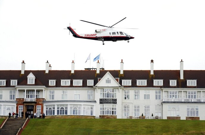 FILE - In this Aug. 1, 2015, file photo, then-presidential candidate Donald Trump leaves by his helicopter on the third day of the Women's British Open golf championship at the Turnberry golf course in Turnberry, Scotland. The Air Force is reviewing how crews on international travel choose airports and hotels after one crew recently spent a night at a Trump resort in Scotland. An Air Force spokesman said Monday, Sept. 9, that an initial review of the March stopover in Scotland in which the crew stayed at the Trump Turnberry golf resort adhered to all official guidance and procedures. Brig. Gen. Ed Thomas adds, however, that while lodging at higher-end hotels might be allowable, it might not always be advisable. (AP Photo/Scott Heppell, File)