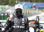 Mercedes driver Valtteri Bottas of Finland, wearing a mask against the spread of the coronavirus, celebrates after he clocked the fastest time during the qualifying session at the Red Bull Ring racetrack in Spielberg, Austria, Saturday, July 4, 2020. The Austrian Formula One Grand Prix will be held on Sunday. (Mark Thompson/Pool via AP)