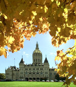 """FILE - This Tuesday Oct. 19, 1999 file photo shows the Connecticut state Capitol framed by fall foliage in Hartford, Conn. Gov. Ned Lamont helped launch the $1.4 million """"Full Color Connecticut"""" marketing campaign Friday, Sept. 10, 2021 which he said will link leaf peeping to other attractions across the state. (AP Photo/Bob Child, File)"""