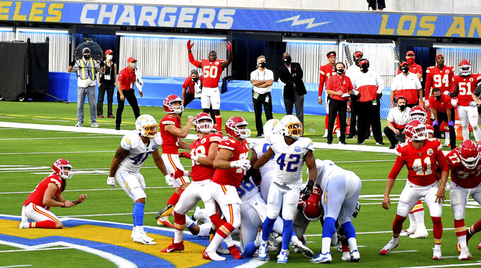 Kicker Harrison Butker, 7,  of the Kansas City Chiefs kicks the winning field goal in overtime as the Kansas City Chiefs defeated the Los Angeles Chargers 23-20 during an NFL football game at SoFi Stadium in Inglewood, Calif., on Sunday, Sept. 20, 2020.  (Keith Birmingham/The Orange County Register via AP)