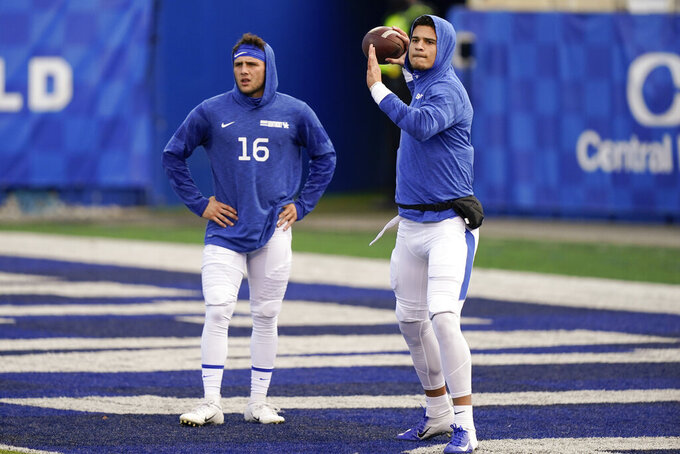 Kentucky quarterbacks Joey Gatewood (2) and Nik Scalzo (16) warm up before an NCAA college football game against Georgia, Saturday, Oct. 31, 2020, in Lexington, Ky. (AP Photo/Bryan Woolston)