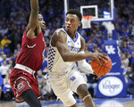 Kentucky's Ashton Hagans, right, passes around South Carolina's Tre Campbell during the first half of an NCAA college basketball game in Lexington, Ky., Tuesday, Feb. 5, 2019. (AP Photo/James Crisp)