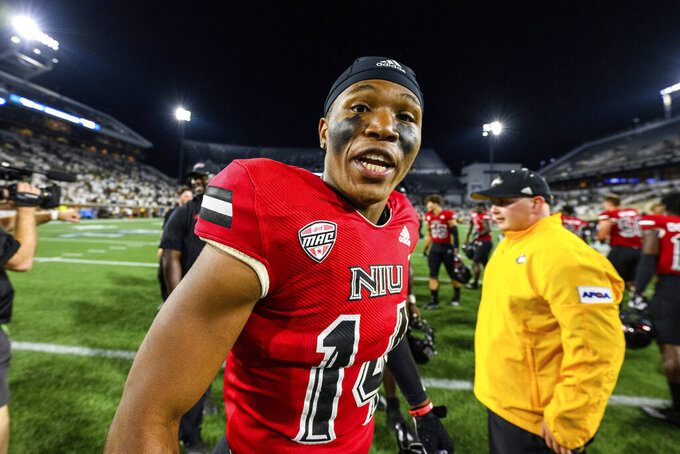 Northern Illinois wide receiver Jeremiah Howard (14) celebrates after the team's NCAA college football game against Georgia Tech on Saturday, Sept. 4, 2021, in Atlanta. Northern Illinois won 22-21. (AP Photo/Danny Karnik)
