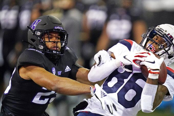 Arizona's Stanley Berryhill III (86) catches a 30-yard pass in the end zone for a touchdown as Washington's Julius Irvin defends during the second half of an NCAA college football game Saturday, Nov. 21, 2020, in Seattle. (AP Photo/Elaine Thompson)