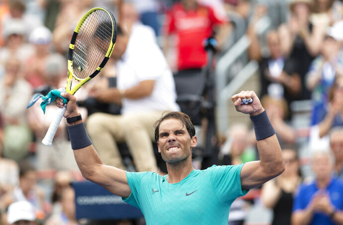 Rafael Nadal of Spain celebrates his victory over Daniel Evans of Great Britain during second round of play at the Rogers Cup tennis tournament Wednesday August 7, 2019 in Montreal. THE CANADIAN PRESS/Paul Chiasson/The Canadian Press via AP)