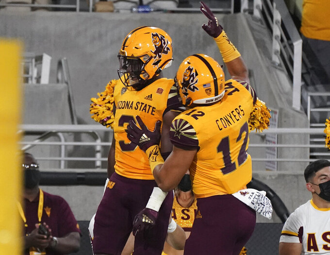 Arizona State running back Rachaad White (3) and tight end Jalin Conyers (12) celebrate White's touchdown against Colorado during the first half of an NCAA college football game Saturday, Sept 25, 2021, in Tempe, Ariz. (AP Photo/Darryl Webb)