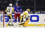 New York Rangers' Pavel Buchnevich celebrates his goal against Pittsburgh Penguins goalie Casey DeSmith during the third period of an NHL hockey game Tuesday, April 6, 2021, in New York. (Bruce Bennett/Pool Photo via AP)