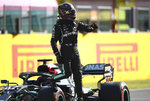 Mercedes driver Lewis Hamilton of Britain steps out of his car after clocking the best time during qualification ahead of the Grand Prix of Tuscany, at the Mugello circuit in Scarperia, Italy, Saturday, Sept. 12, 2020. Hamilton will take pole position for the Formula One Grand Prix of Tuscany on Sunday. (Bryn Lennon, Pool via AP)