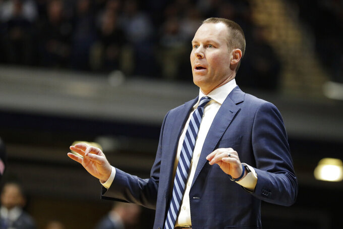 Xavier head coach Travis Steele gestures in the first half of an NCAA college basketball game against Butler in Indianapolis, Wednesday, Feb. 12, 2020. (AP Photo/Michael Conroy)