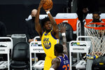 Golden State Warriors center James Wiseman (33) shoots over Phoenix Suns center Deandre Ayton during the first half of an NBA basketball game, Thursday, March 4, 2021, in Phoenix. (AP Photo/Rick Scuteri)