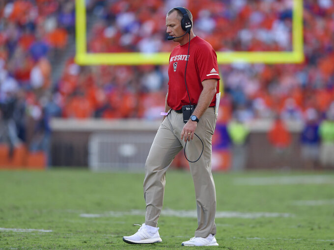 North Carolina State head coach Dave Doeren walks across the field during the second half of an NCAA college football game against Clemson, Saturday, Oct. 20, 2018, in Clemson, S.C. (AP Photo/Richard Shiro)