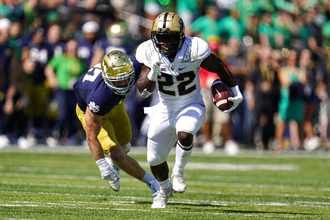 Purdue running back King Doerue (22) runs past Notre Dame linebacker JD Bertrand (27) during the first half of an NCAA college football game in South Bend, Ind., Saturday, Sept. 18, 2021. (AP Photo/Michael Conroy)