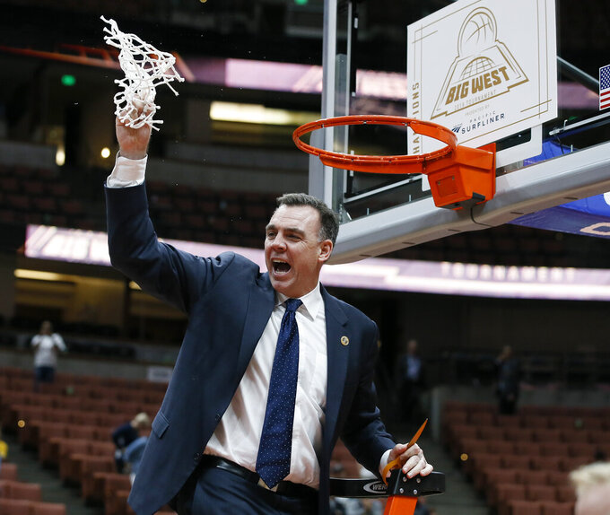 UC Irvine head coach Russell Turner celebrates after cutting down the net after his team defeated Cal State Fullerton 94-64 in an NCAA college basketball game for the Big West men's tournament championship in Anaheim, Calif., Saturday, March 16, 2019. (AP Photo/Alex Gallardo)