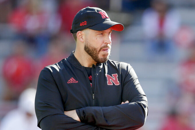 In this Sept. 15, 2018, photo, Nebraska defensive coordinator Erik Chinander follows warmups in Lincoln, Neb., before an NCAA college football game. Chinander was a Hawkeye through and through as a kid growing up in eastern Iowa and as a walk-on offensive lineman and graduate of Iowa. Now he's a Cornhusker, the defensive coordinator at Nebraska, and he assures everyone he is not conflicted going into the game Friday at Kinnick Stadium in Iowa City. His parents and other family and friends will be there, too, and they'll all be wearing red. (AP Photo/Nati Harnik)