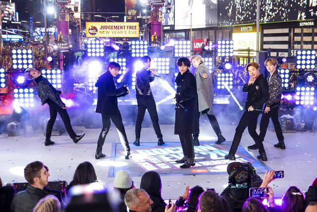 "FILE - Members of BTS perform at the Times Square New Year's Eve celebration in New York on Dec. 31, 2019. The K-pop band is nominated for a Grammy Award for best pop duo/group performance with ""Dynamite,"