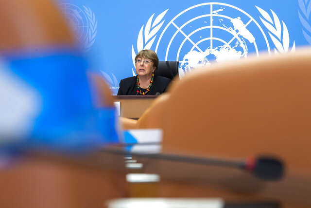 Michelle Bachelet, UN High Commissioner for Human Rights, speaks about 2020 and looking ahead to 2021, during a press conference at the European headquarters of the United Nations in Geneva, Switzerland, Wednesday, Dec. 9, 2020.  Michelle Bachelet spoke to reporters in Geneva in a catch-all news conference to recap the year and look ahead to 2021. (Martial Trezzini/Keystone via AP)