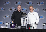 Northwestern head coach Pat Fitzgerald, left, and Ohio State head coach Urban Meyer pose for a photo during a news conference for the Big Ten Conference championship NCAA college football game, Friday, Nov. 30, 2018, in Indianapolis. Northwestern will play Ohio State on Saturday for the championship. (AP Photo/Darron Cummings)