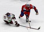 Latvia's Janis Jaks, left, checks Norway's Patrick Thoresen during the Ice Hockey World Championships group B match between Norway and Latvia at the Ondrej Nepela Arena in Bratislava, Slovakia, Tuesday, May 21, 2019. (AP Photo/Ronald Zak)